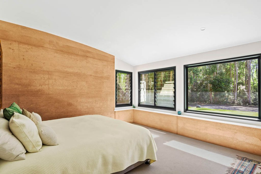 Bedroom, rammed earth and louvres.