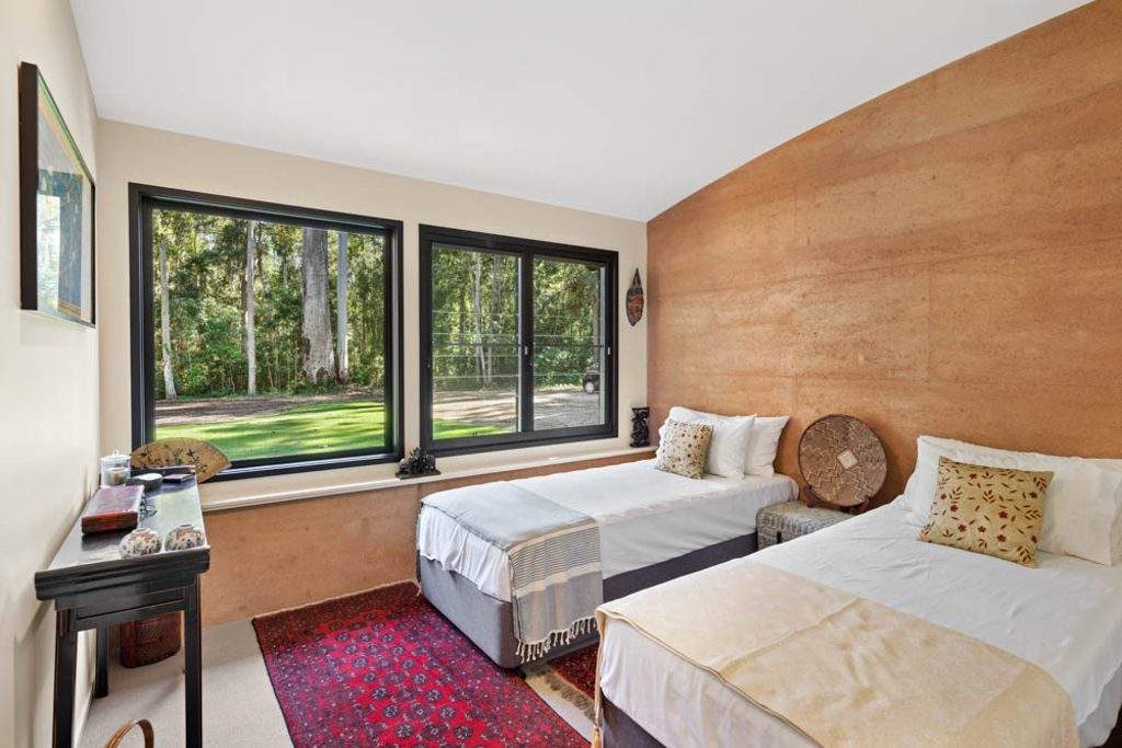 Bedroom rammed earth wall and louvres