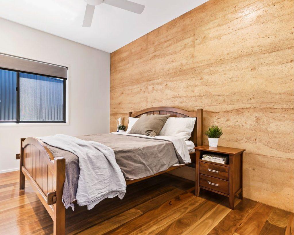 rammed earth bedroom