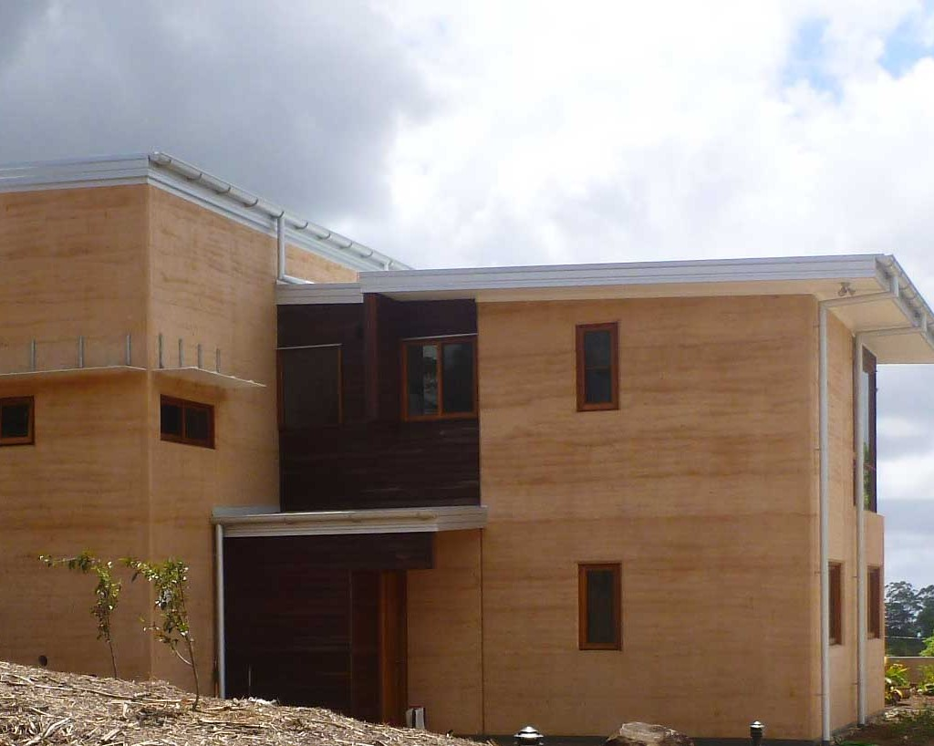 Two storey rammed earth house, small eaves. Maleny.