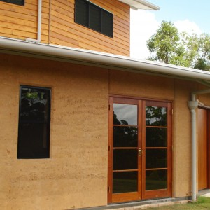 rammed earth curved front home