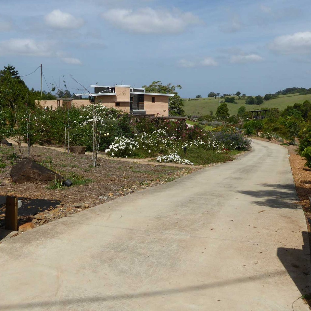 Rammed earth driveway entry gates