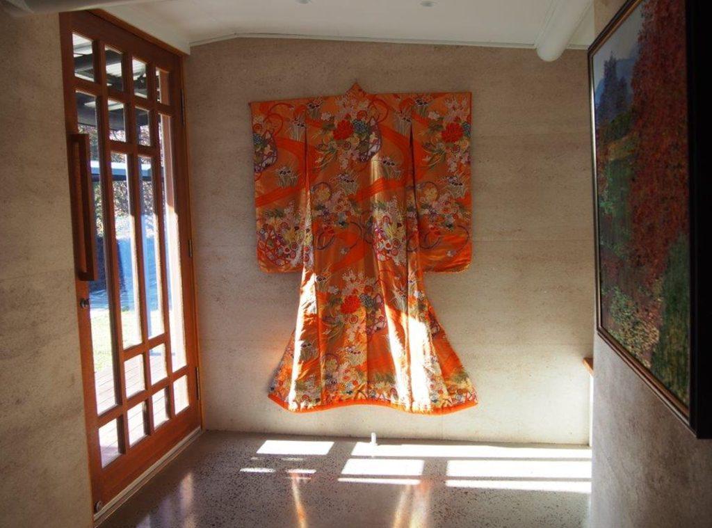 Kimono on rammed earth wall