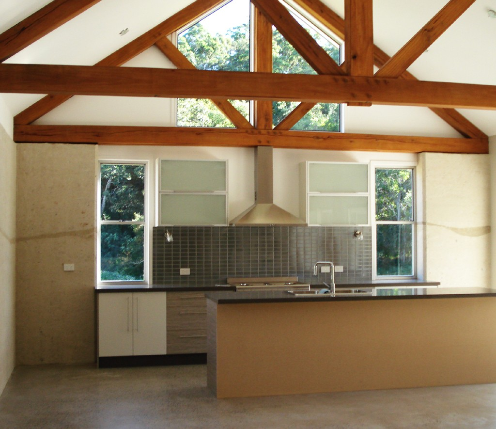 Kitchen with rammed earth ribbon of colour
