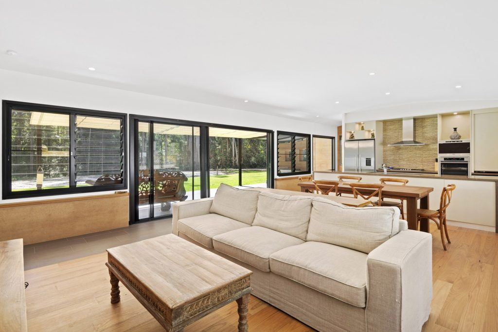 Open plan living, rammed earth, louvres