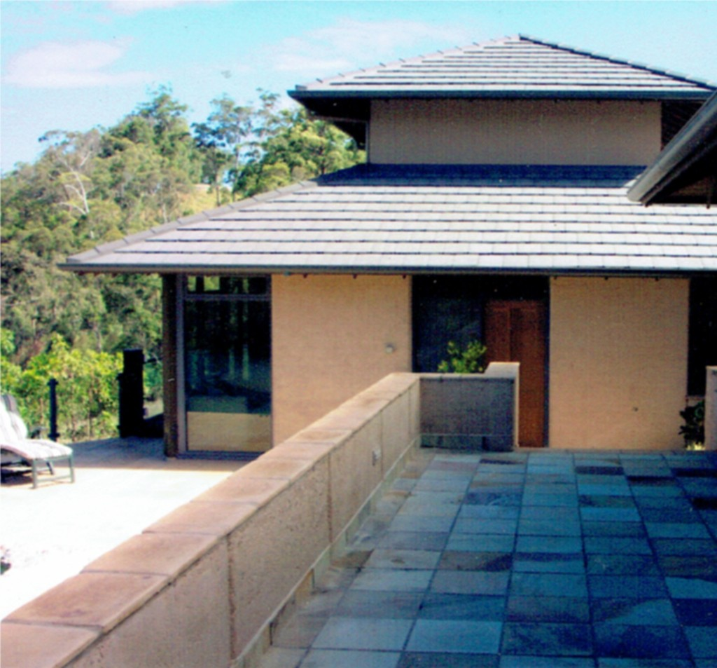 rammed earth patio walls and pool house