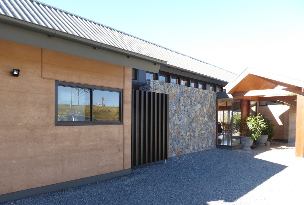 Mt Mee rammed earth house entry