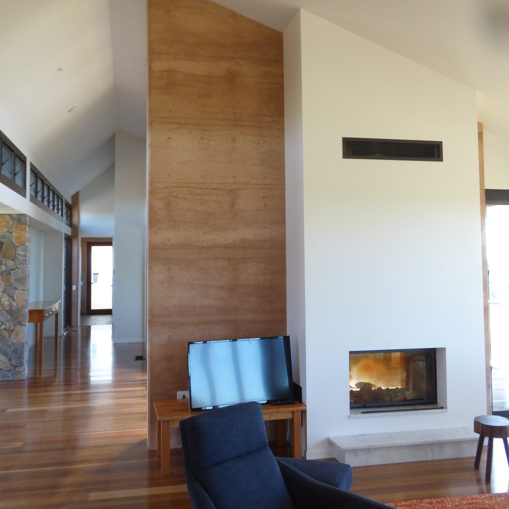 rammed earth, stone and gyprock