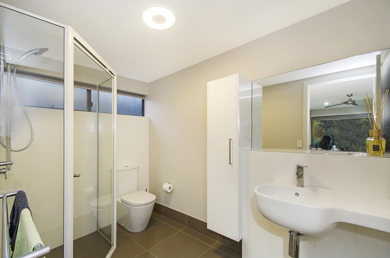 Bathroom in rammed earth home, Queensland