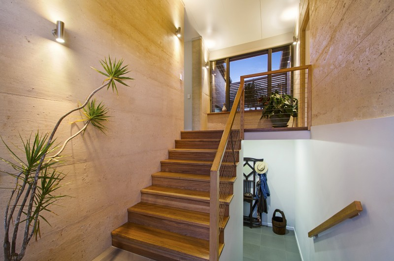 Rammed earth staircase, two storey home