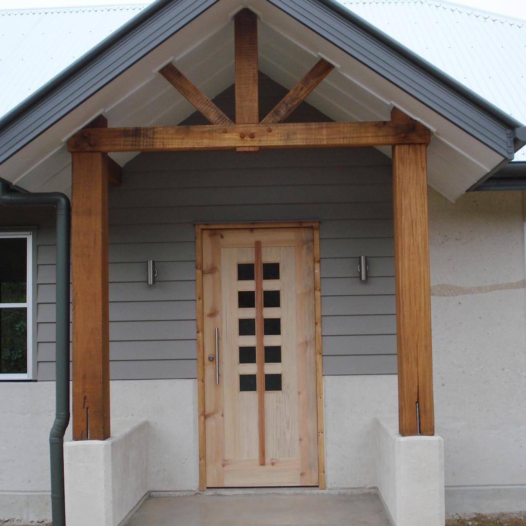 rammed earth house front door