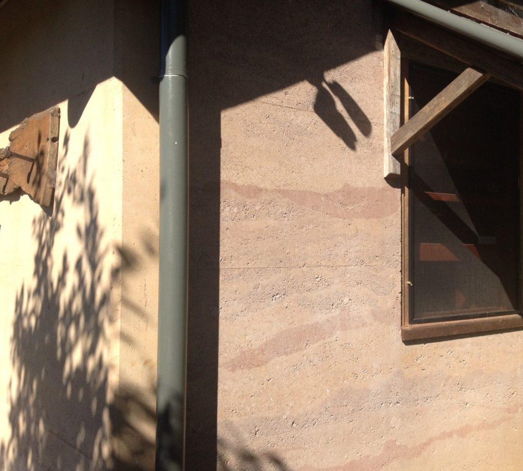 feature rammed earth wall country cabin