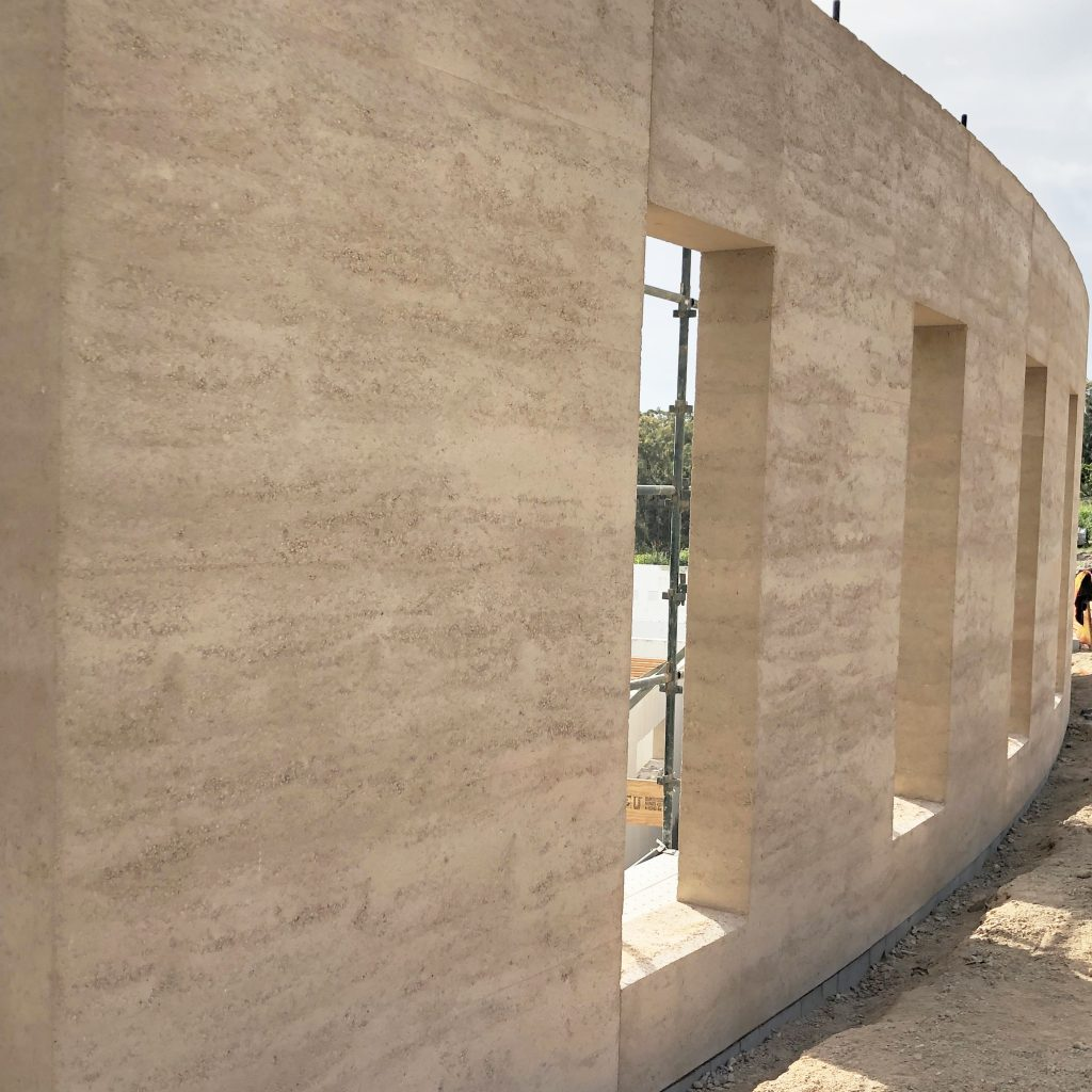 fresh curved rammed earth wall
