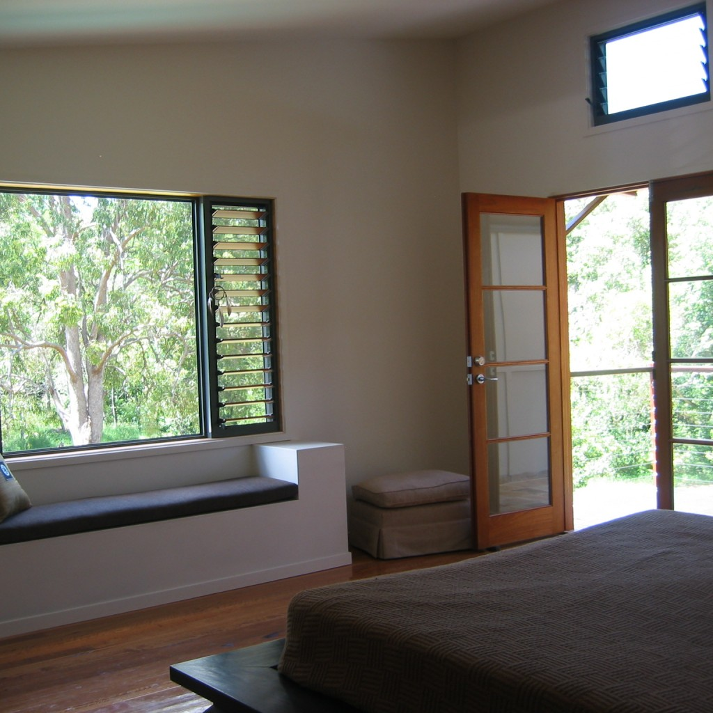 Bedroom, rammed earth, colourbond and fc sheeting home, near Noosa.