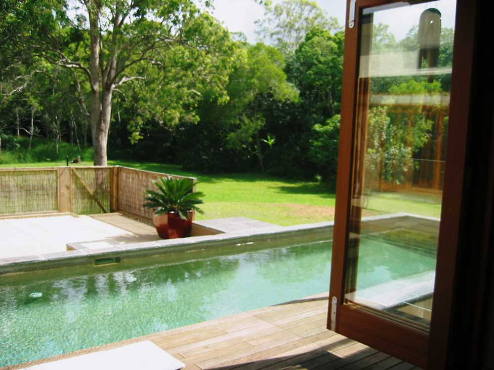 Pool view, rammed earth home near Noosa