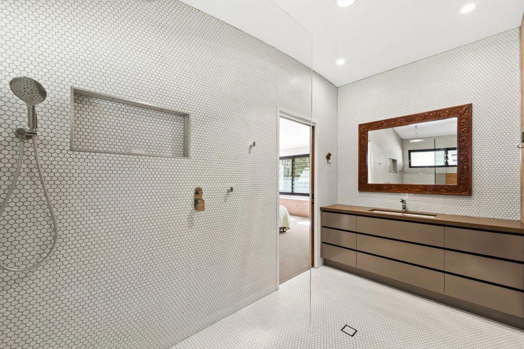 Tiled bathroom in rammed earth house
