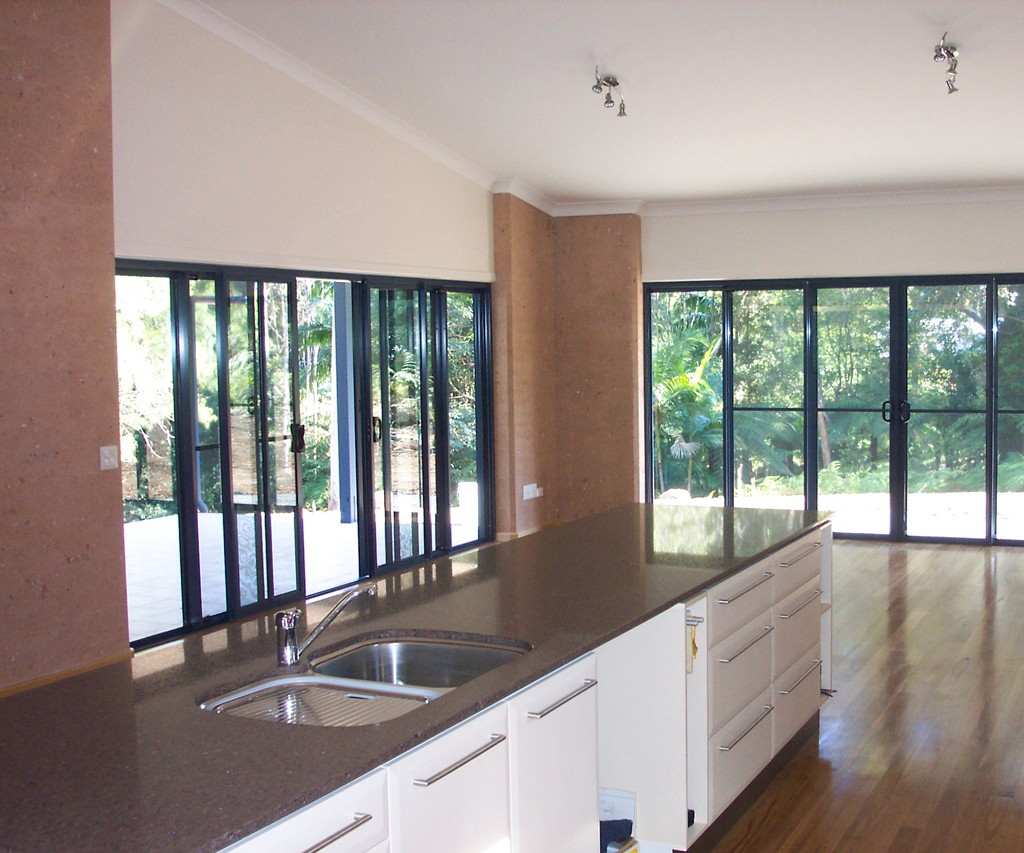 kitchen to dining room, rammed earth