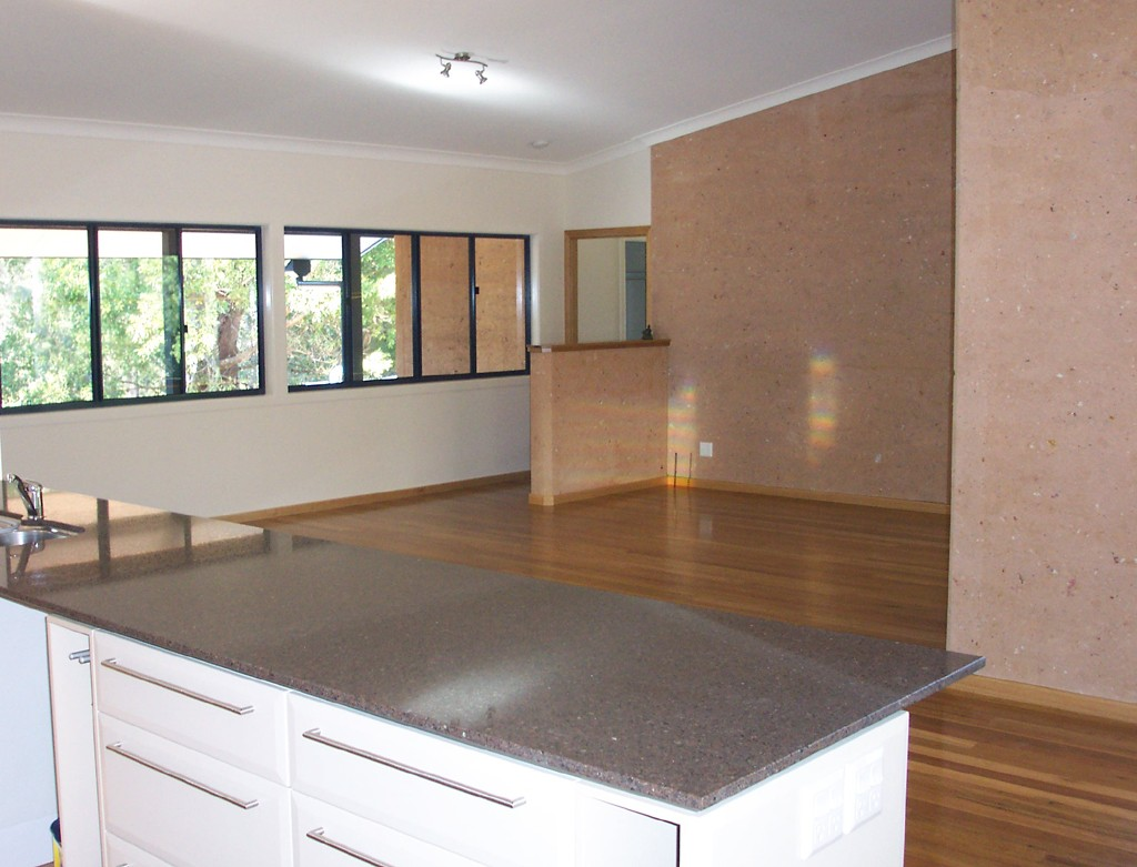 kitchen to living room, rammed earth