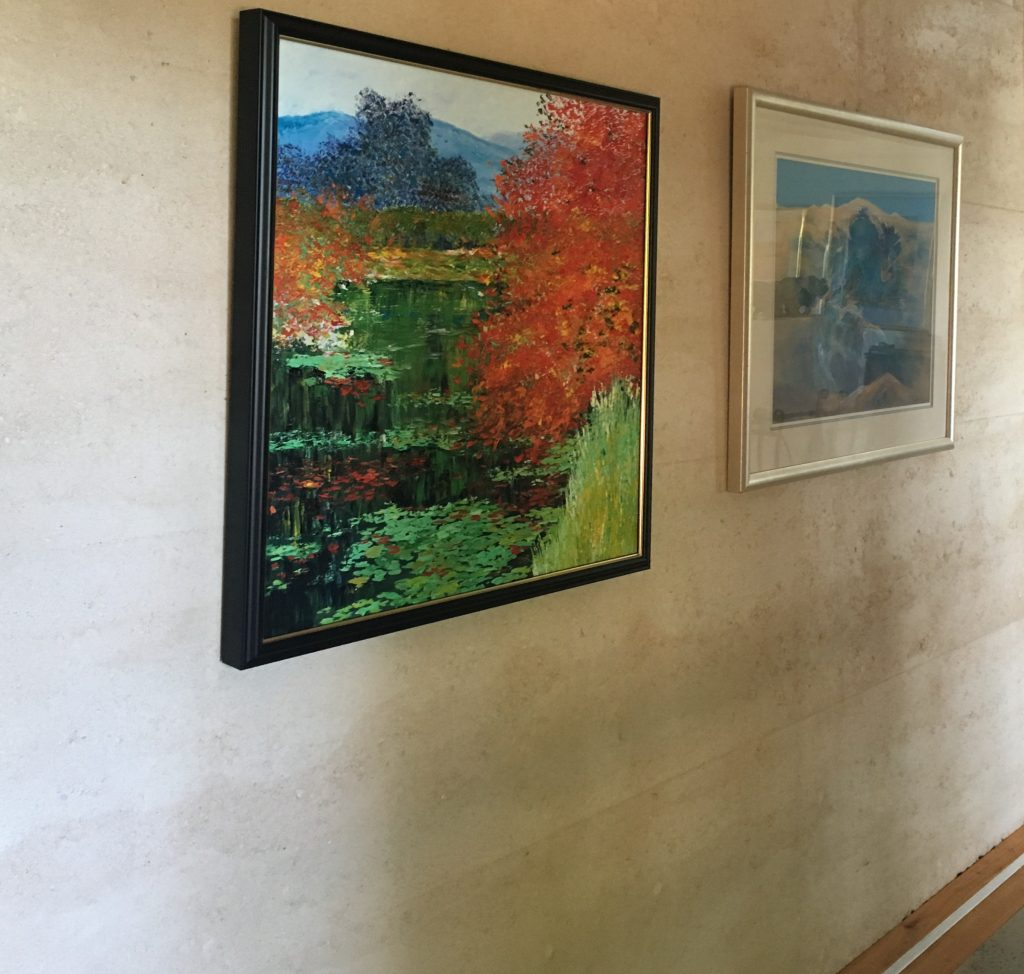 paintings on rammed earth wall