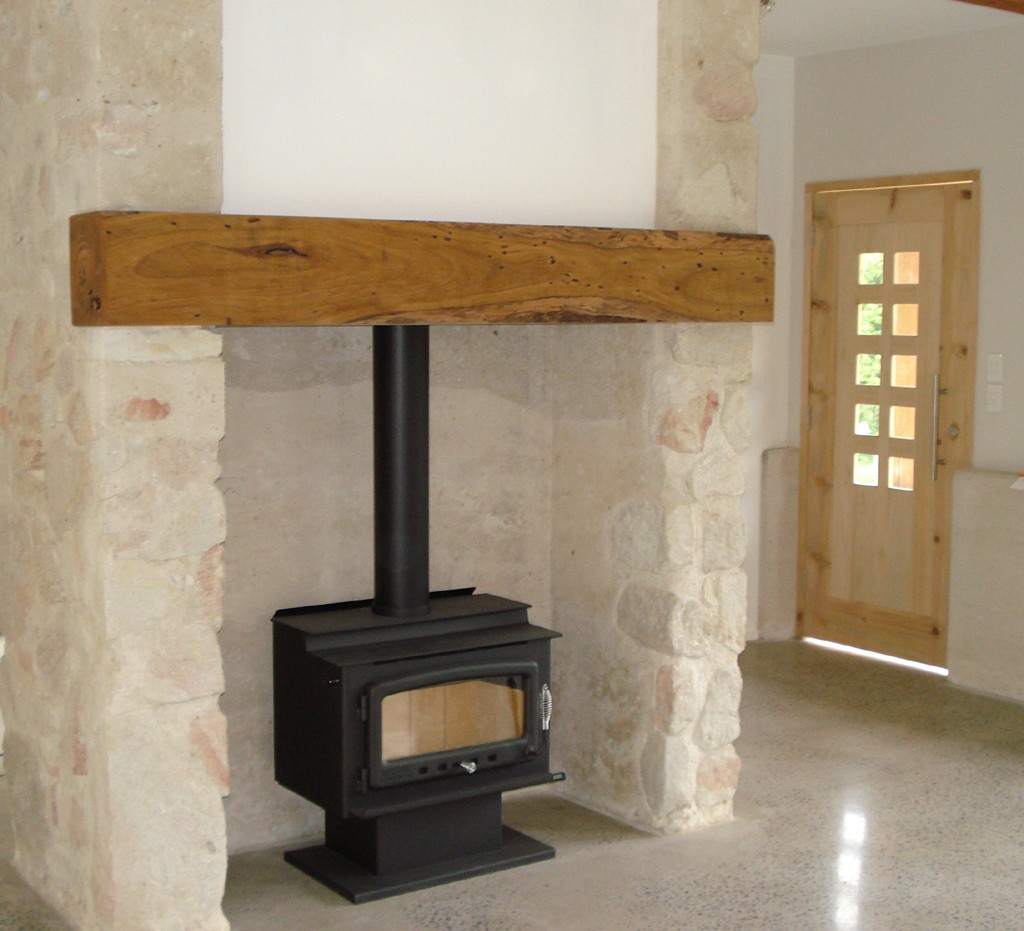 rammed earth and stone fireplace