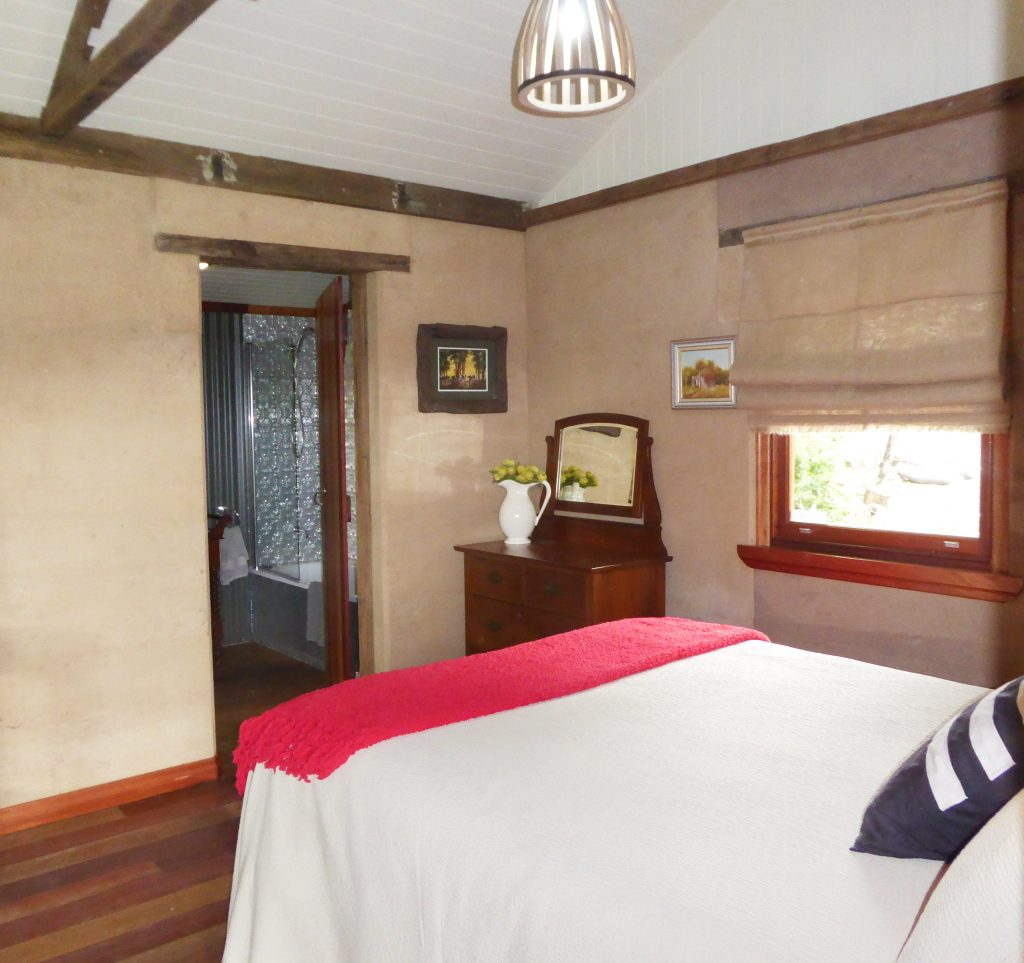 rammed earth cabin bedroom
