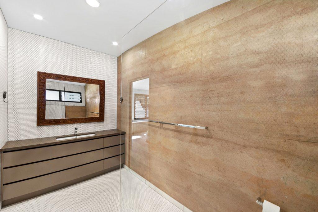 rammed earth bathroom wall