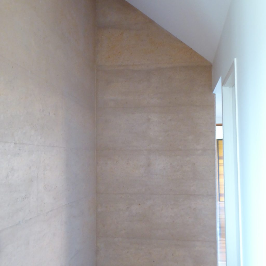 rammed earth hallway walls. Mt Mee rammed earth and timber home, SE Qld.