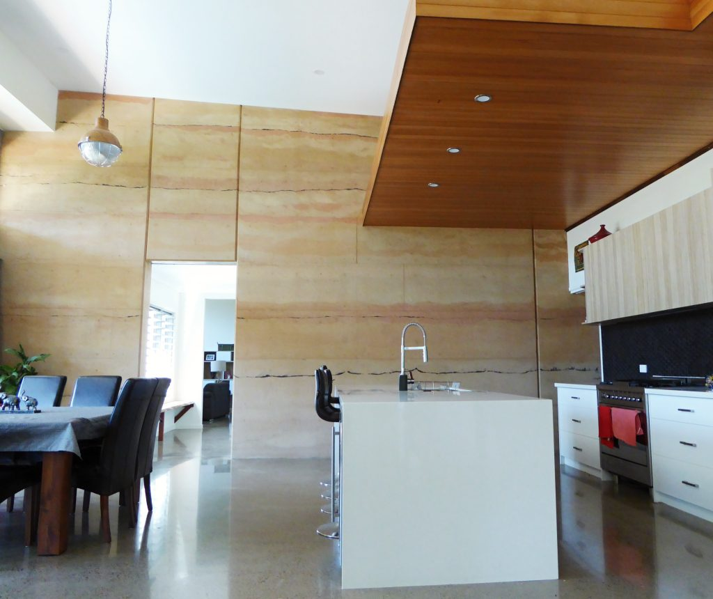 rammed earth kitchen feature wall