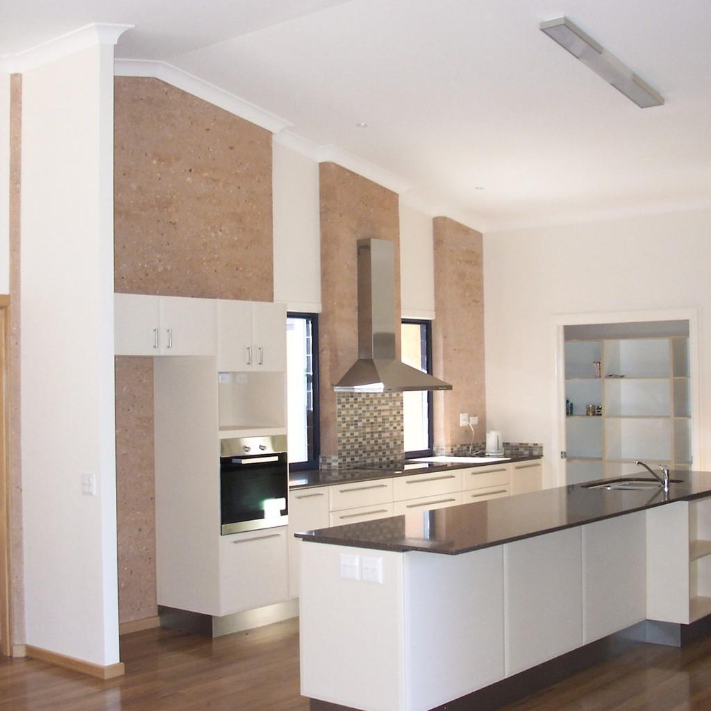 rammed earth kitchen walls