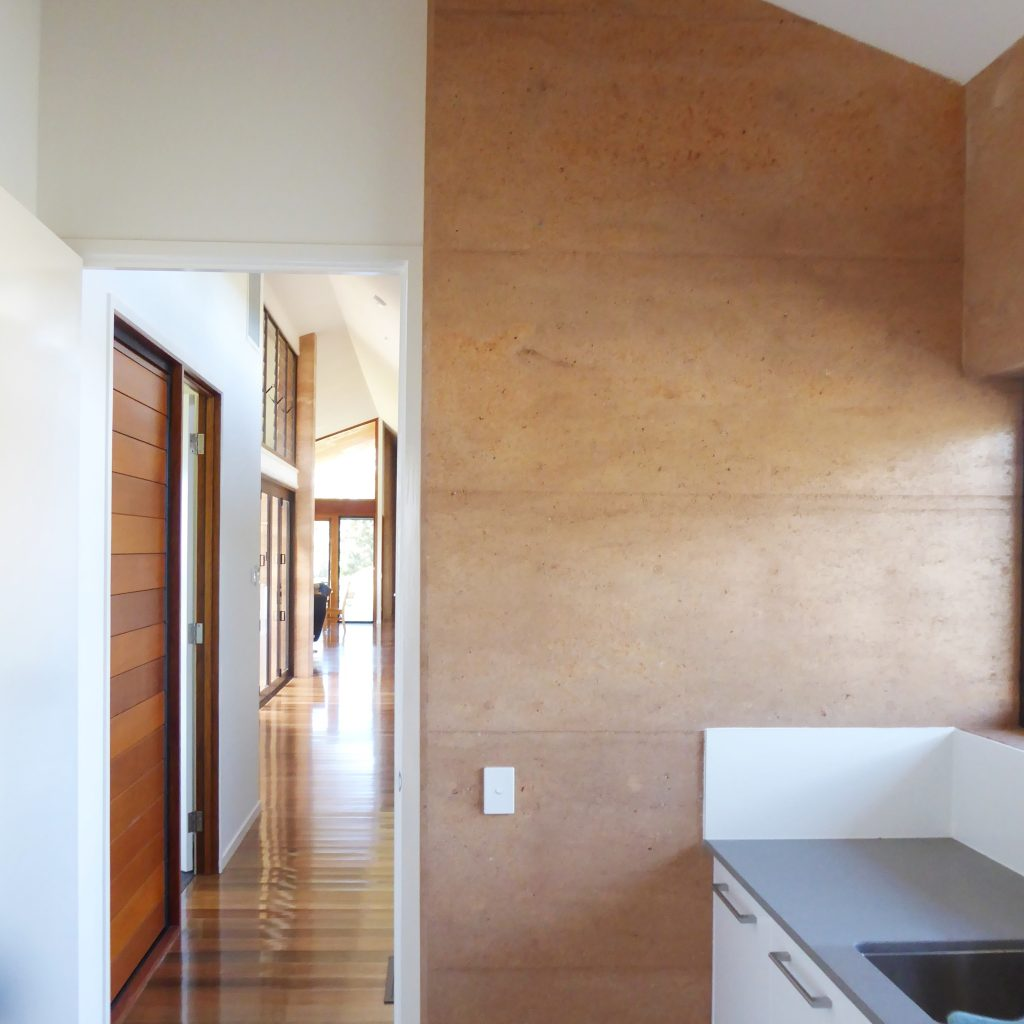 rammed earth wall in laundry