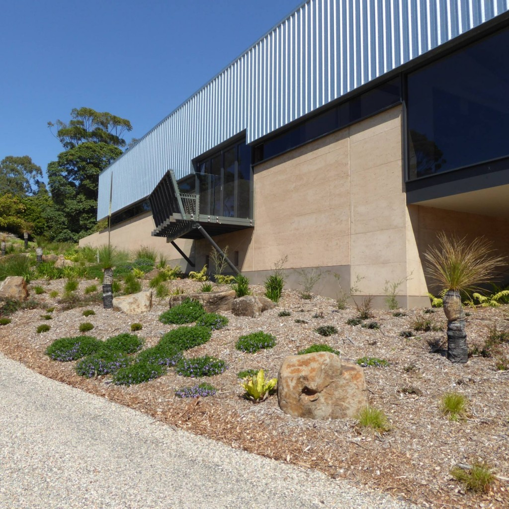 Rammed earth wall, cantilever deck