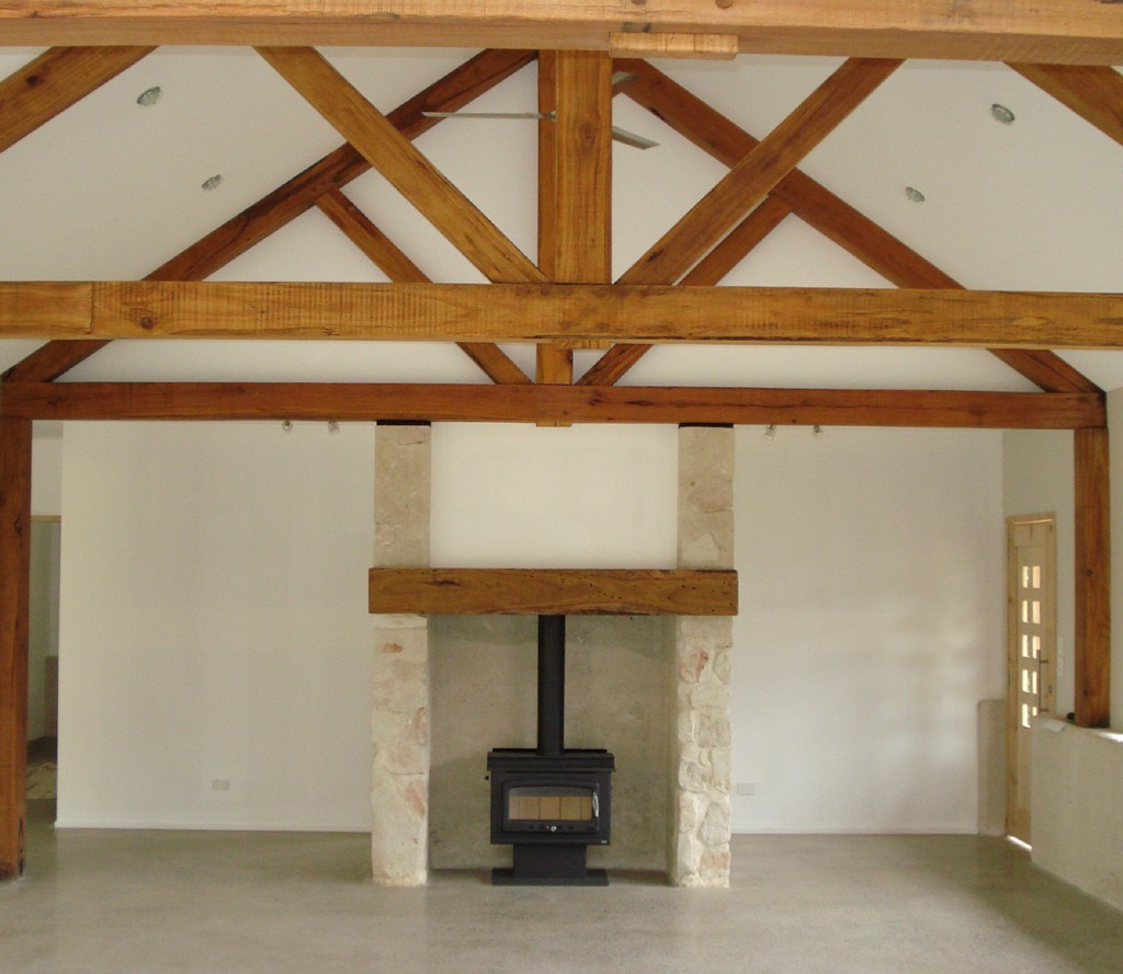 timber beams rammed earth fireplace