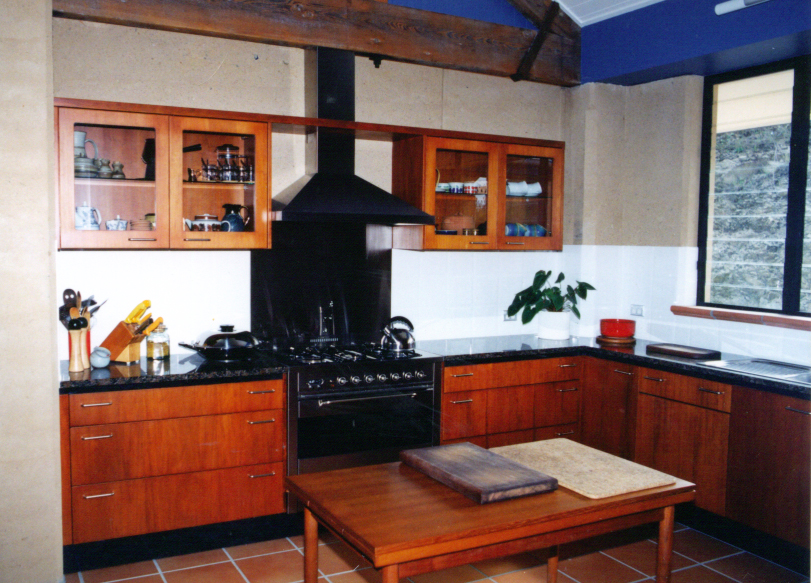 Kitchen in country rammed earth home, Samford, Queensland